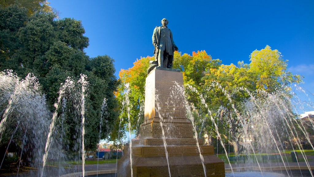 Franklin Square featuring a square or plaza, a fountain and a statue or sculpture