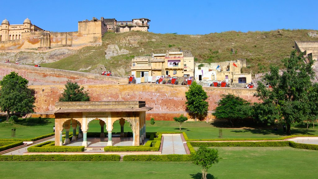 Amber Fort which includes a castle, heritage architecture and a garden