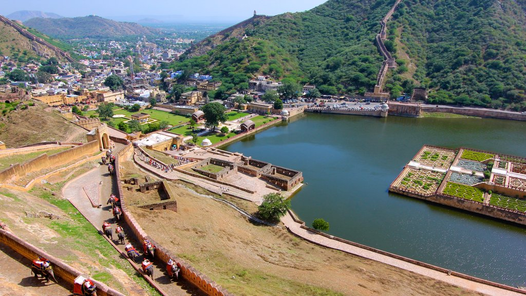 Amber Fort showing a city, a lake or waterhole and landscape views