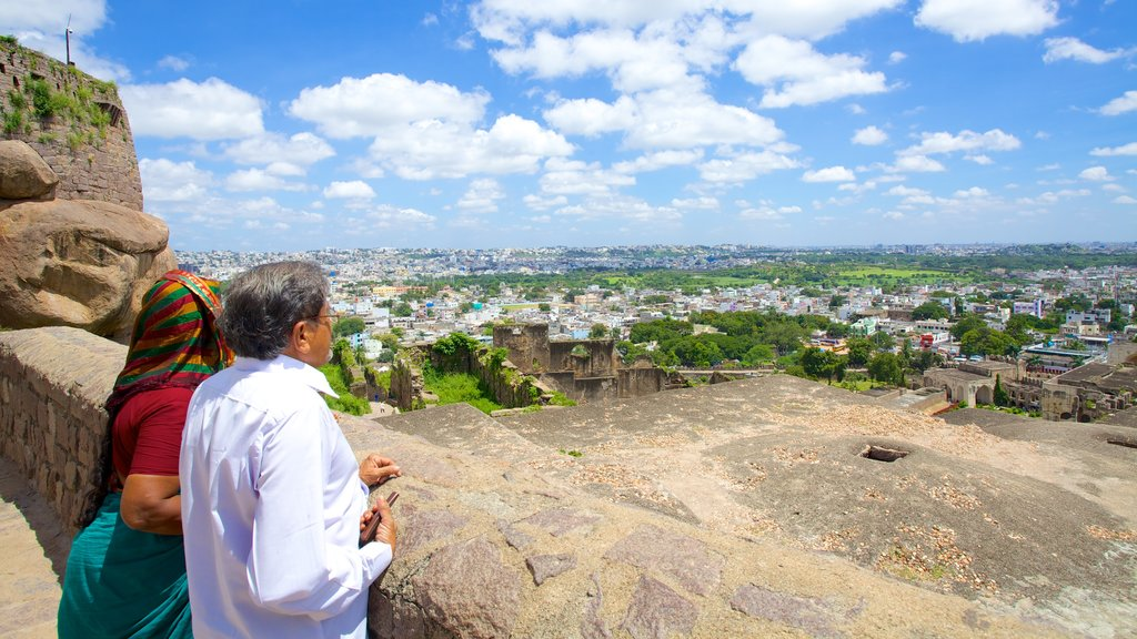 Golconda Fort showing views and a city as well as a couple