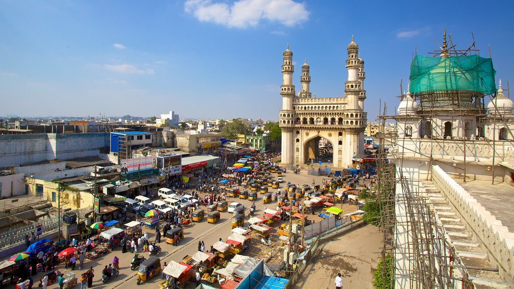 Charminar which includes a square or plaza, a mosque and street scenes