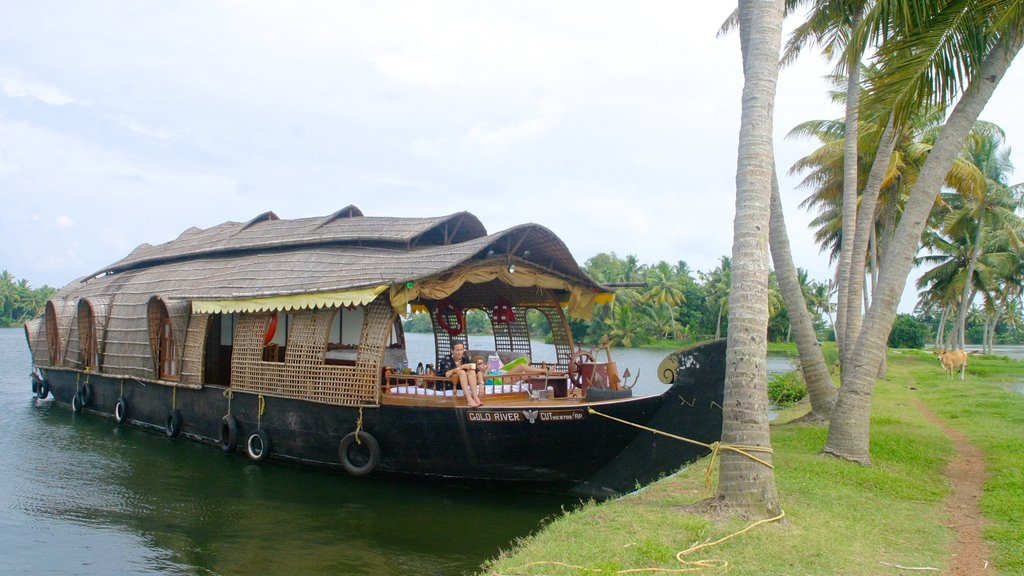 Cochin which includes tropical scenes, boating and a lake or waterhole