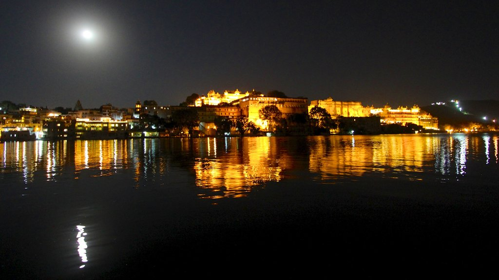 City Palace featuring chateau or palace, a lake or waterhole and night scenes