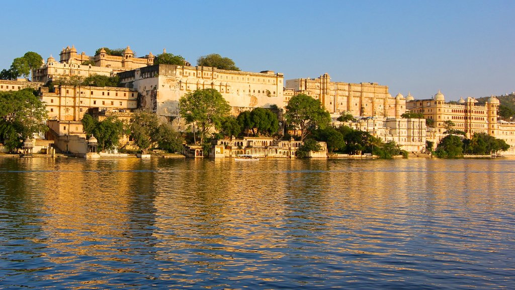 City Palace which includes a castle and a lake or waterhole