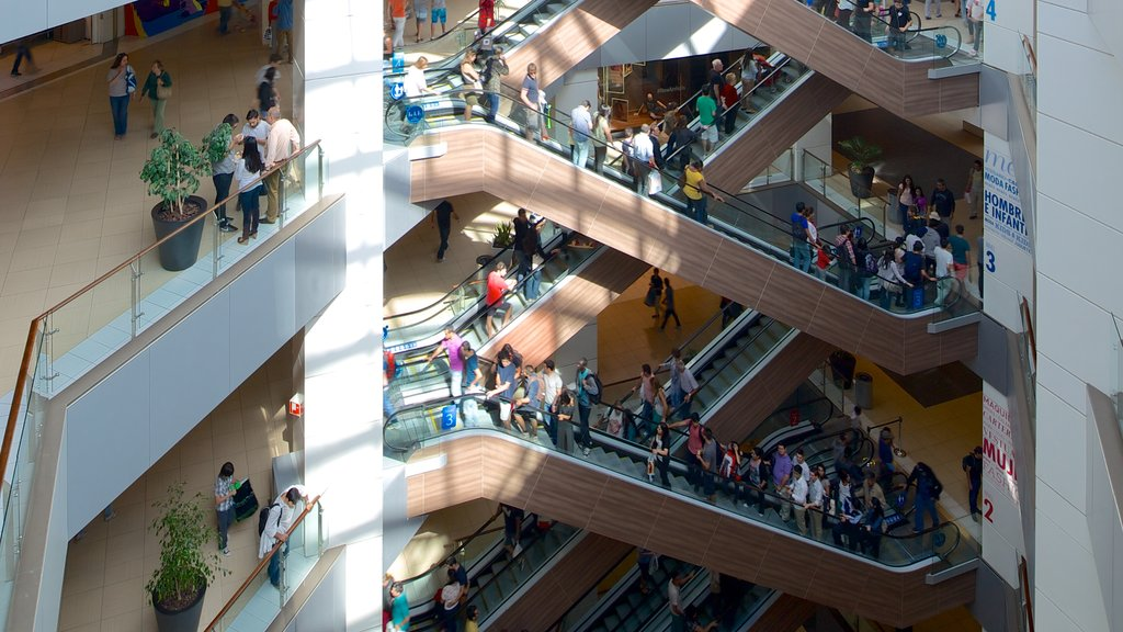 Costanera Center featuring interior views and shopping as well as a large group of people