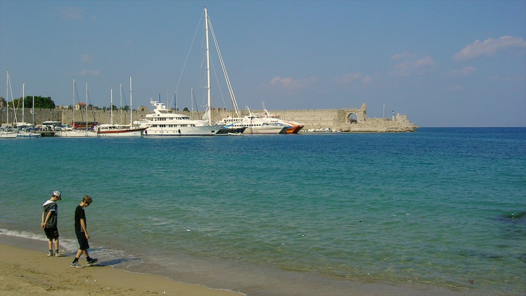 Rhodes which includes a bay or harbor, a sandy beach and boating