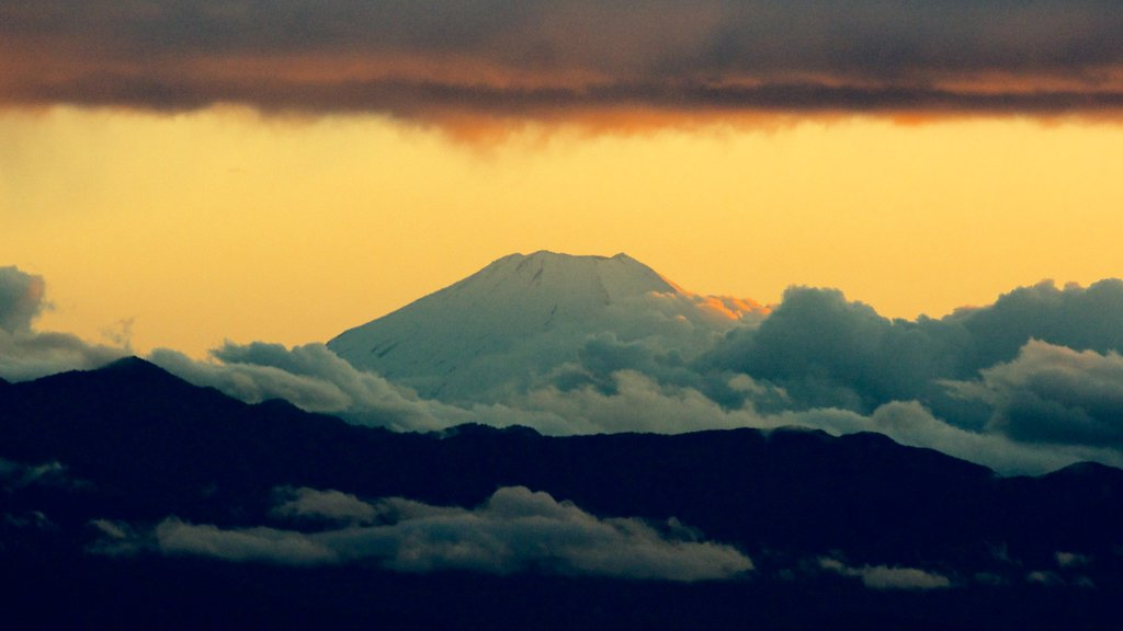 Mount Fuji showing mist or fog, mountains and a sunset