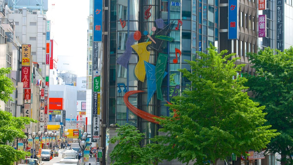 Shinjuku showing signage, a city and street scenes