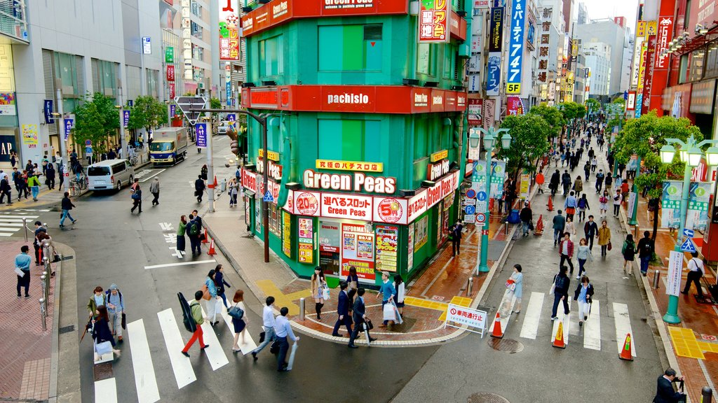 Shinjuku featuring street scenes, signage and a city