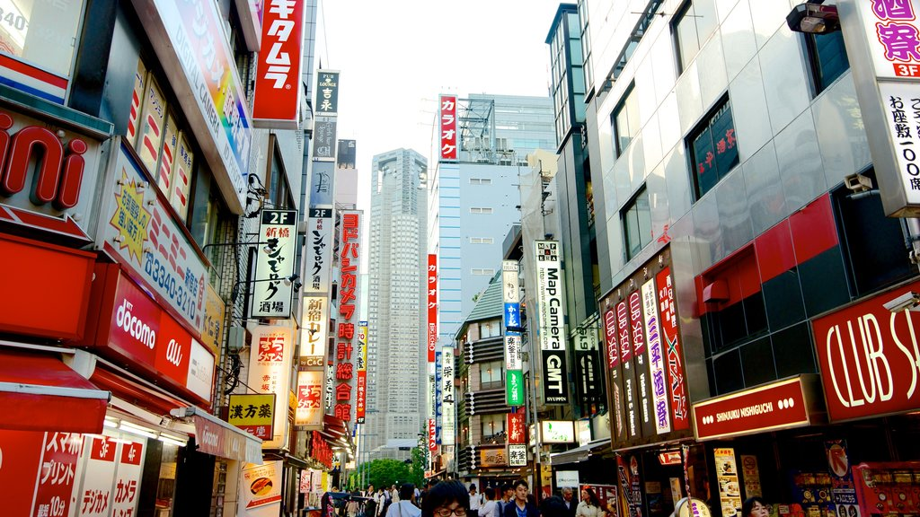 Shinjuku which includes a city, street scenes and signage