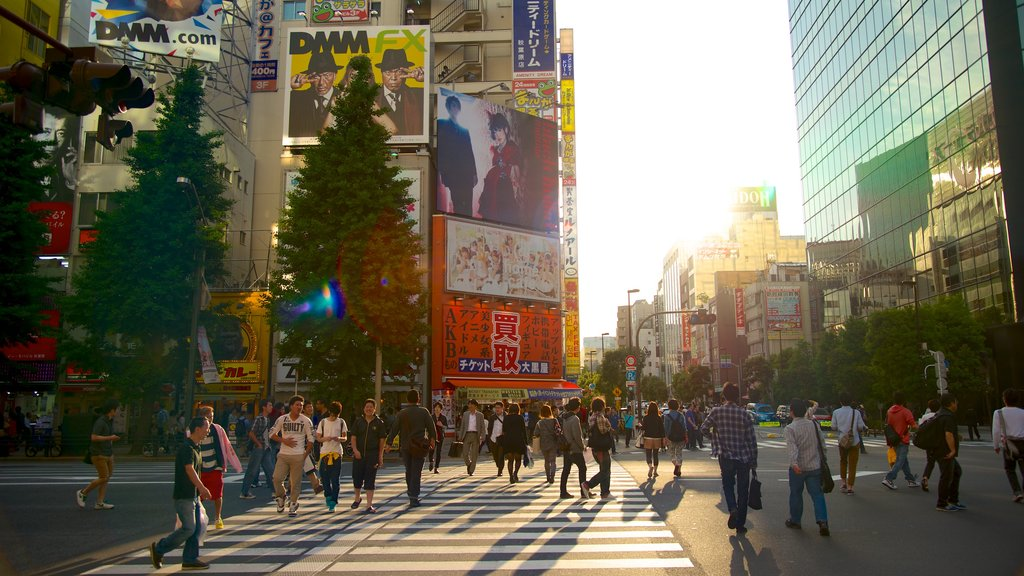 Akihabara Electric Town which includes a city, modern architecture and street scenes