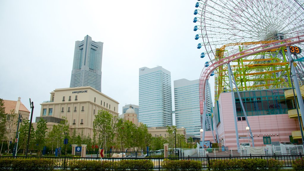 Landmark Tower which includes rides, a high rise building and a city