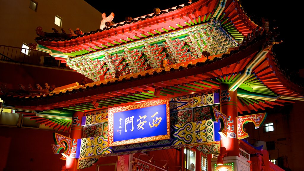 Chinatown featuring signage, heritage architecture and night scenes