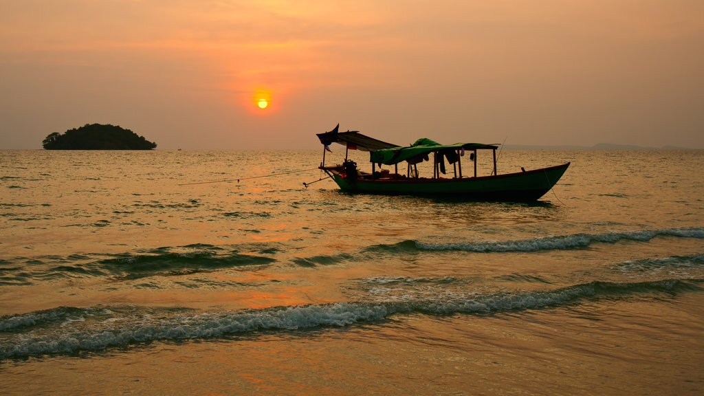 Sihanoukville showing a sandy beach and a sunset
