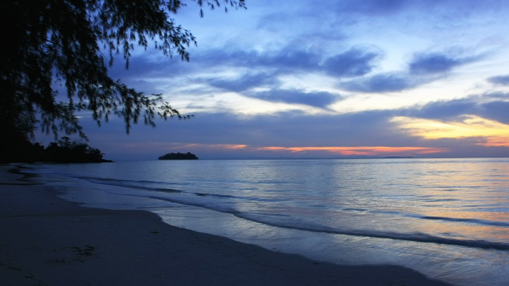 Koh Rong featuring a sunset, a sandy beach and landscape views
