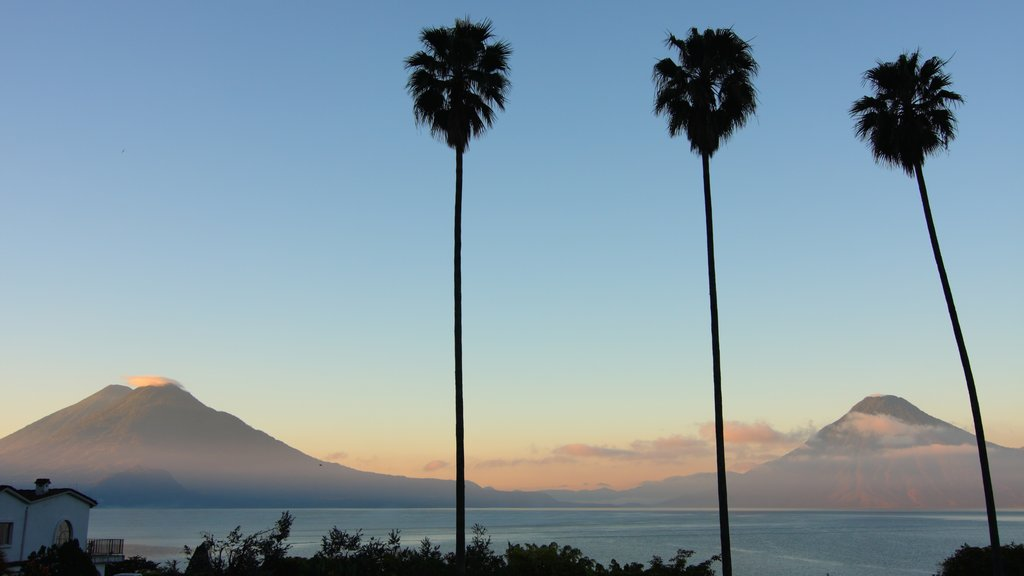 Lake Atitlan which includes landscape views, general coastal views and a sunset