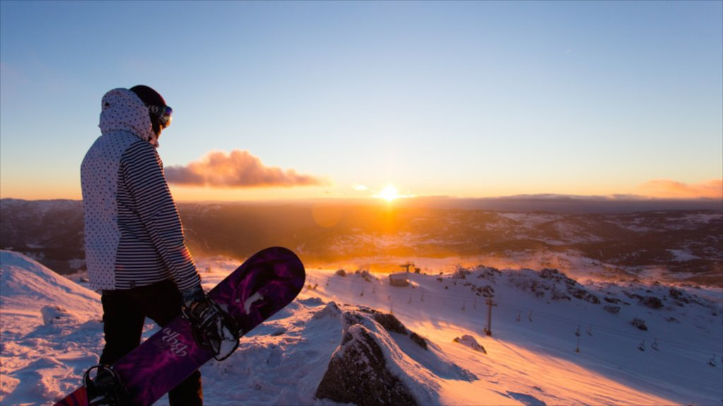 Snowy Mountains featuring landscape views, snow boarding and a sunset