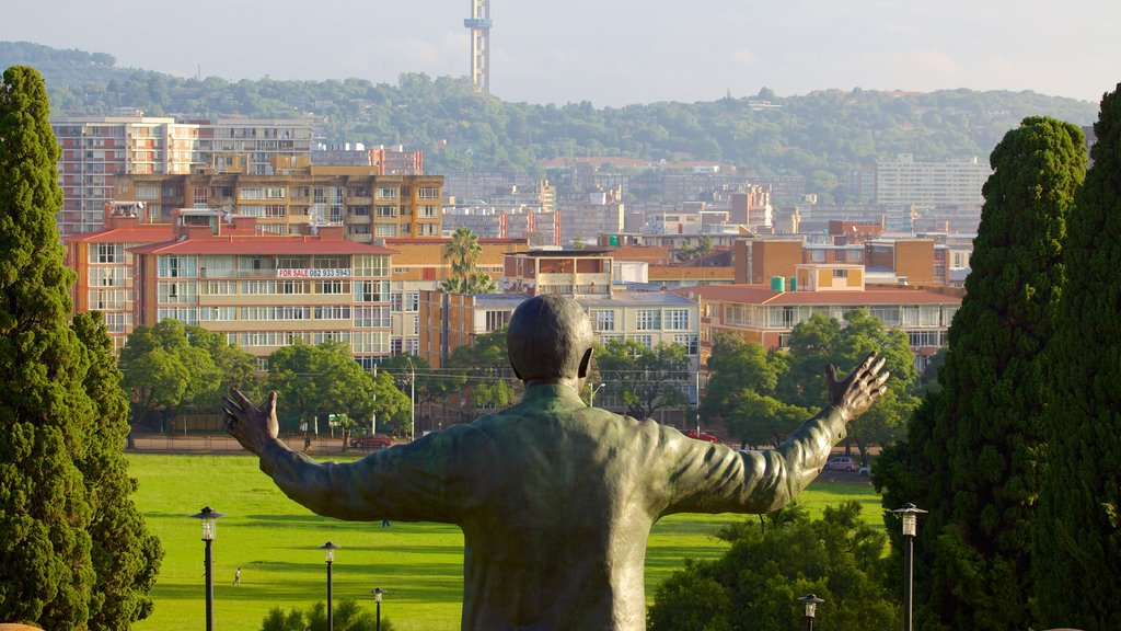 Union Buildings showing a statue or sculpture, a city and outdoor art