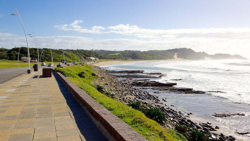 Eastern Beach which includes rocky coastline, a coastal town and landscape views