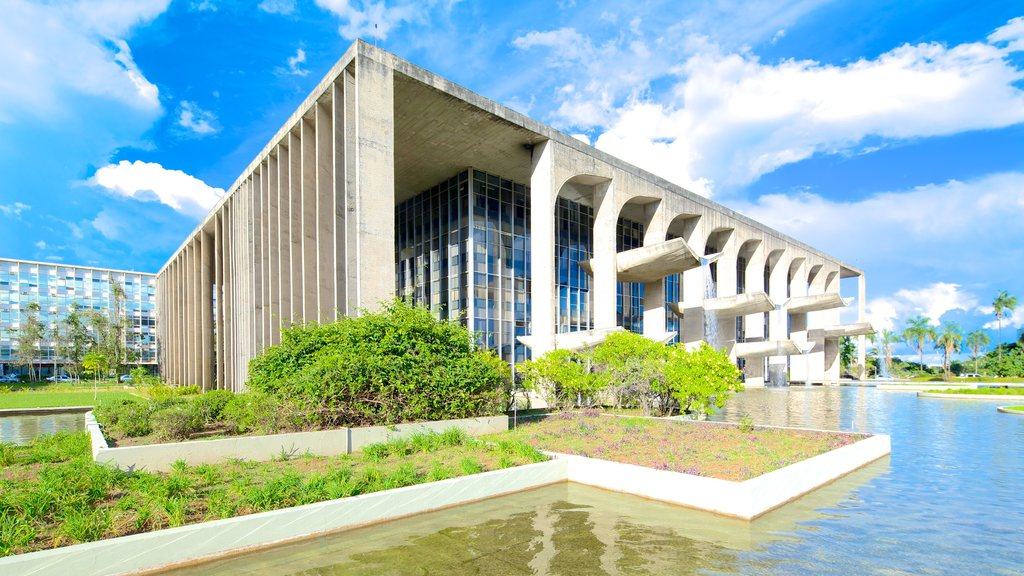 Palace of Justice featuring a pond, modern architecture and a city