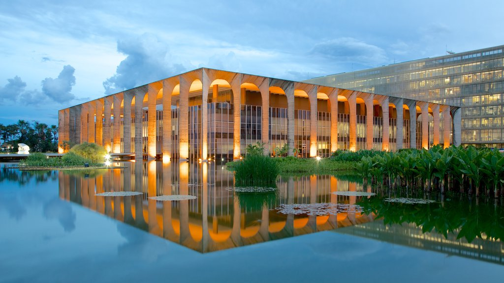 Itamaraty Palace which includes modern architecture, a lake or waterhole and a pond