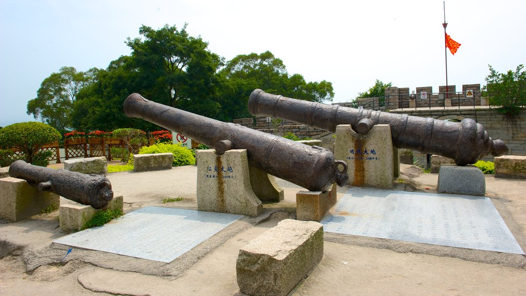 Hulishan Cannon Fort featuring a monument and military items
