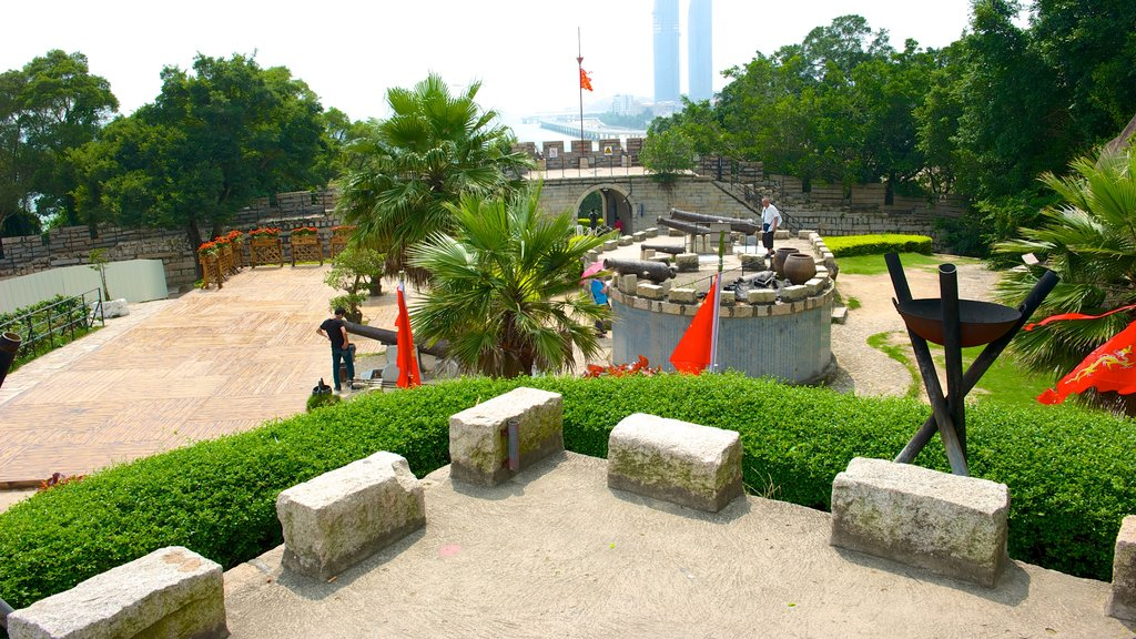 Hulishan Cannon Fort showing outdoor art, a castle and military items
