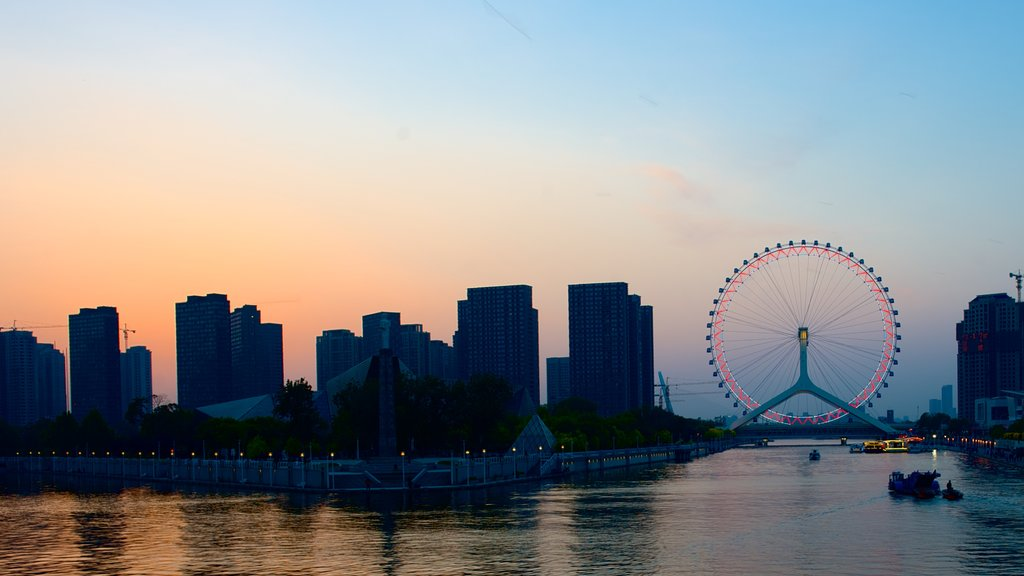 Tianjin Eye showing cbd, a city and night scenes