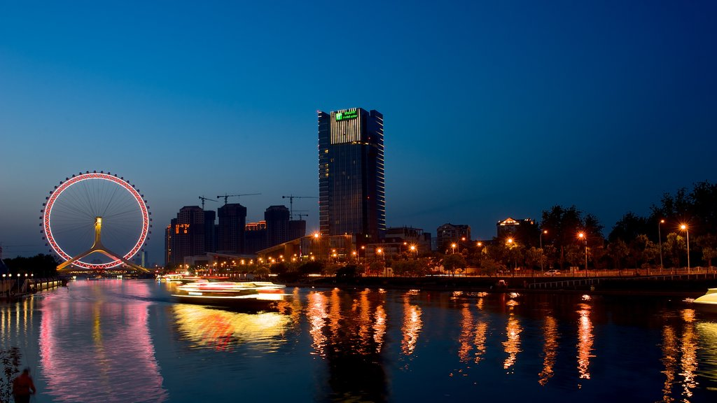 Tianjin Eye showing a river or creek, modern architecture and a high rise building