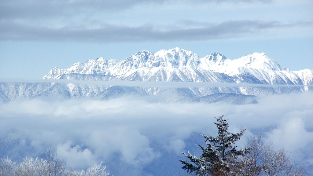 Nagano which includes mountains, snow and mist or fog