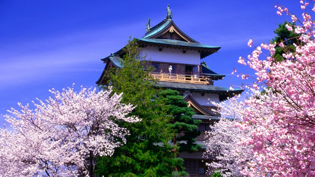 Nagano showing flowers, a temple or place of worship and heritage architecture