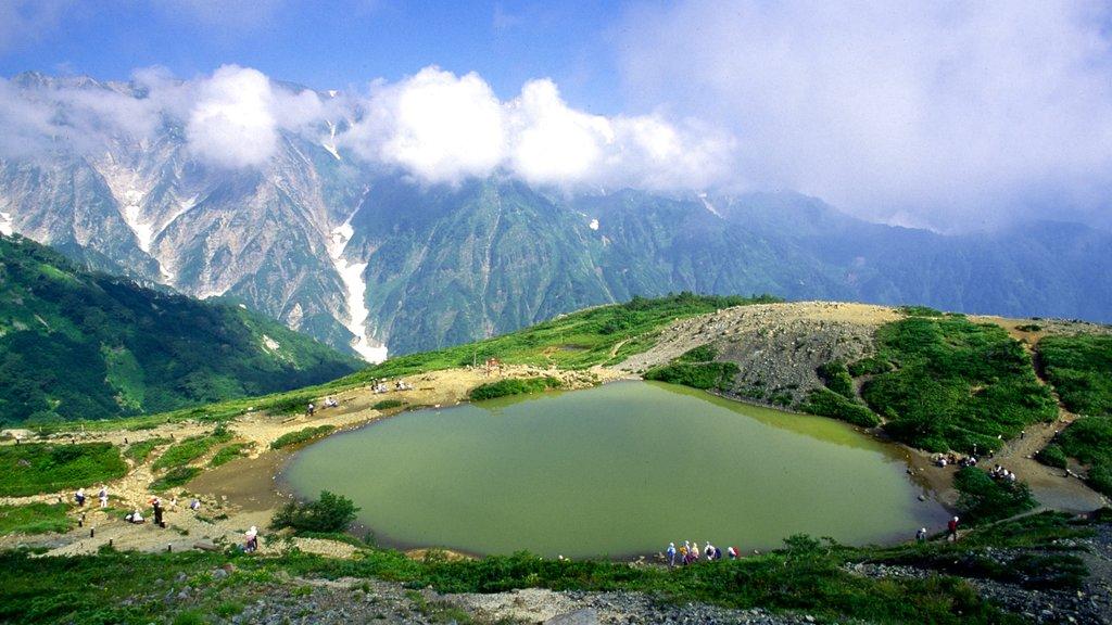 Nagano showing mountains and a lake or waterhole