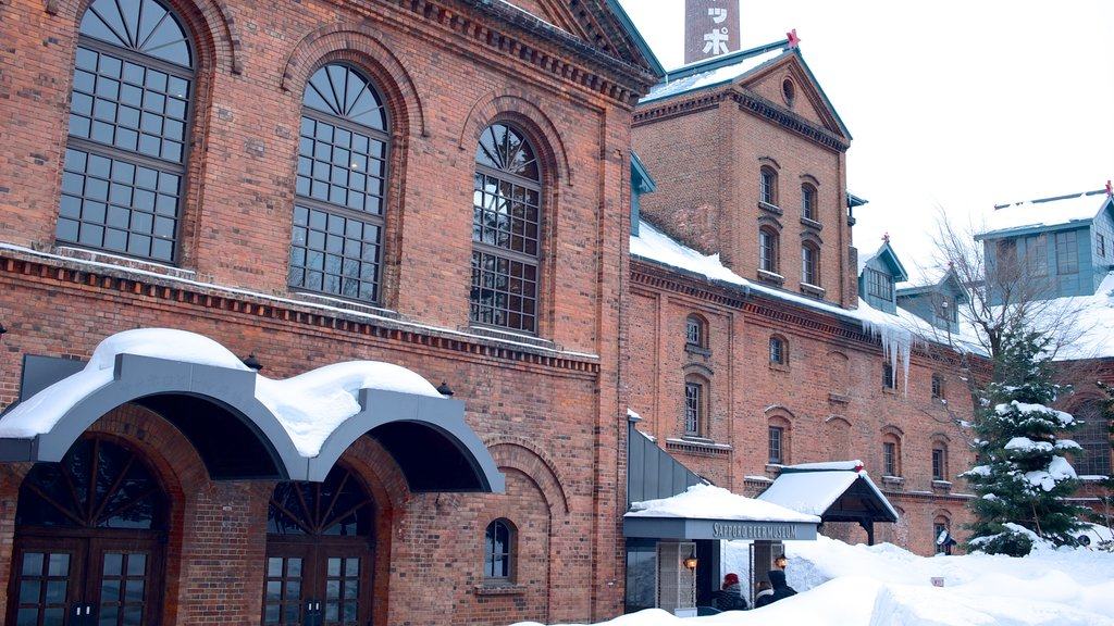 Sapporo Beer Museum which includes heritage architecture, a city and snow