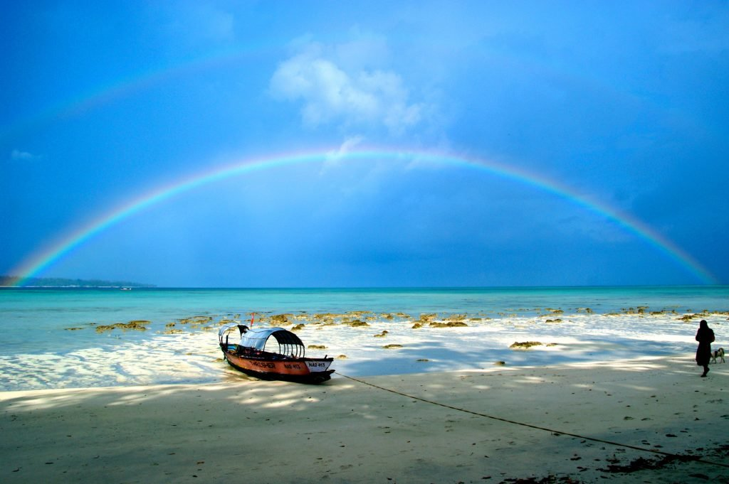 Double rainbow on paradise beach