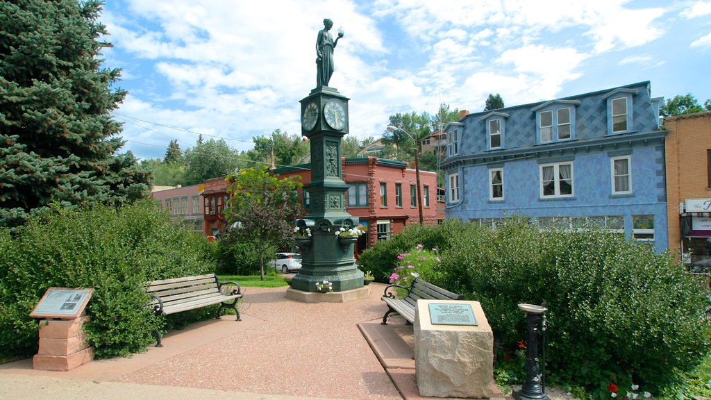 Manitou Springs showing a park, a statue or sculpture and a small town or village
