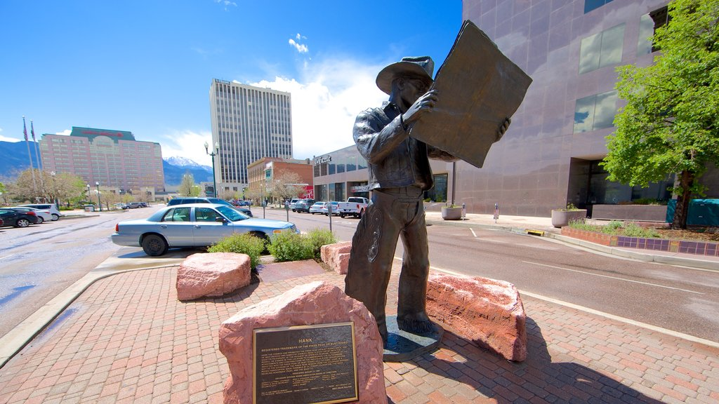 Downtown Colorado Springs which includes street scenes and a statue or sculpture