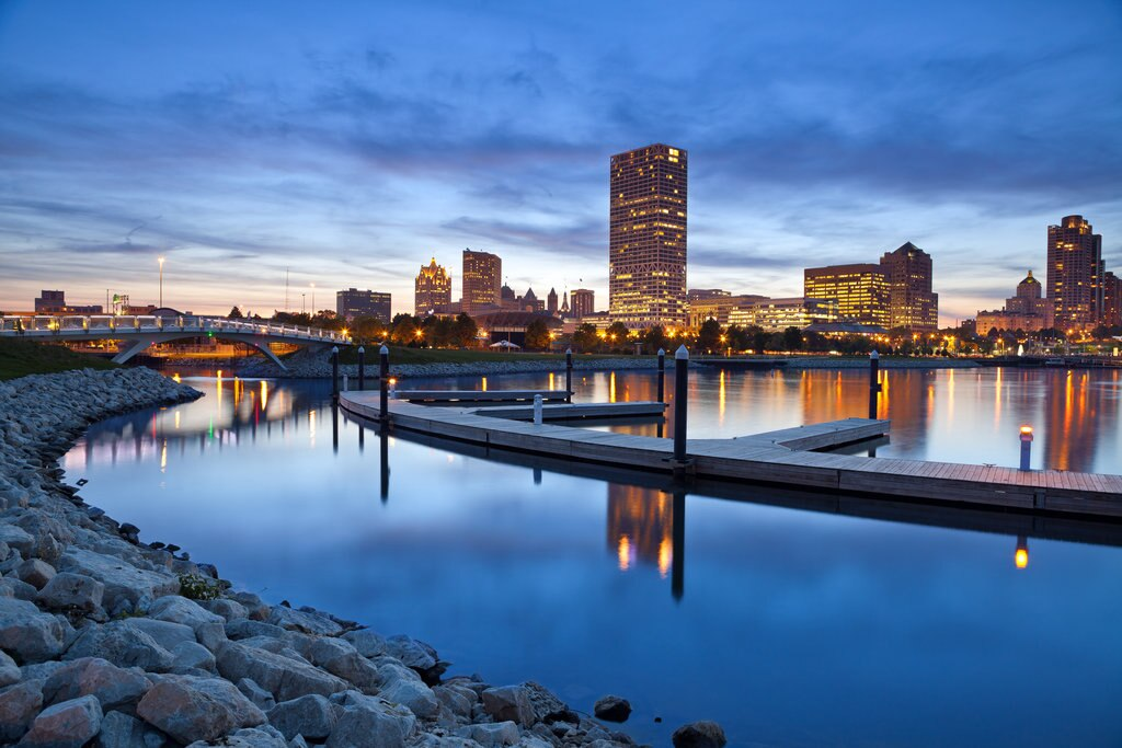01-city-of-milwaukee-skyline-image-of-the-milwaukee-skyline-at-twilight-with-city-reflection-in-lake-michigan-and-harbor-pier