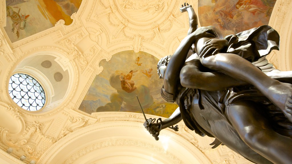 Petit Palais featuring a statue or sculpture and interior views