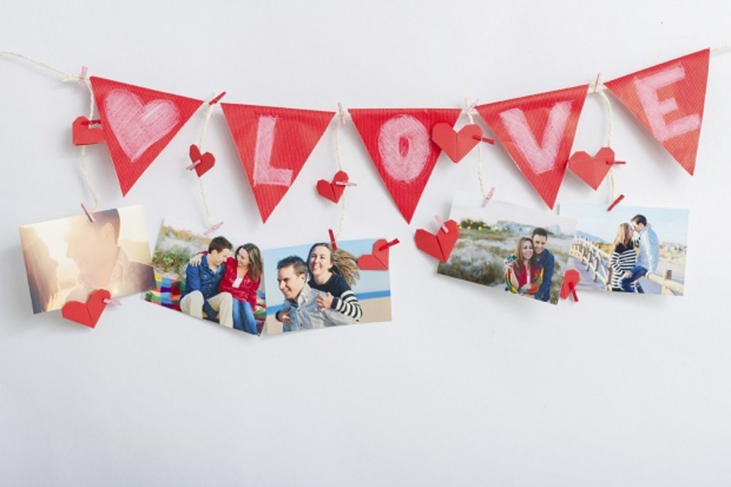 Bunting hung above photographs of a couple