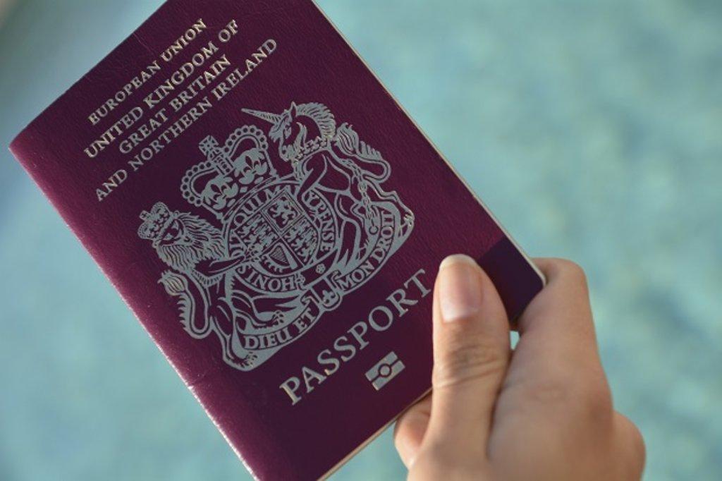 Woman holding a British passport