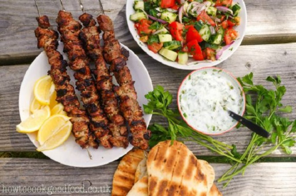 Pork kebabs with salad and pitta