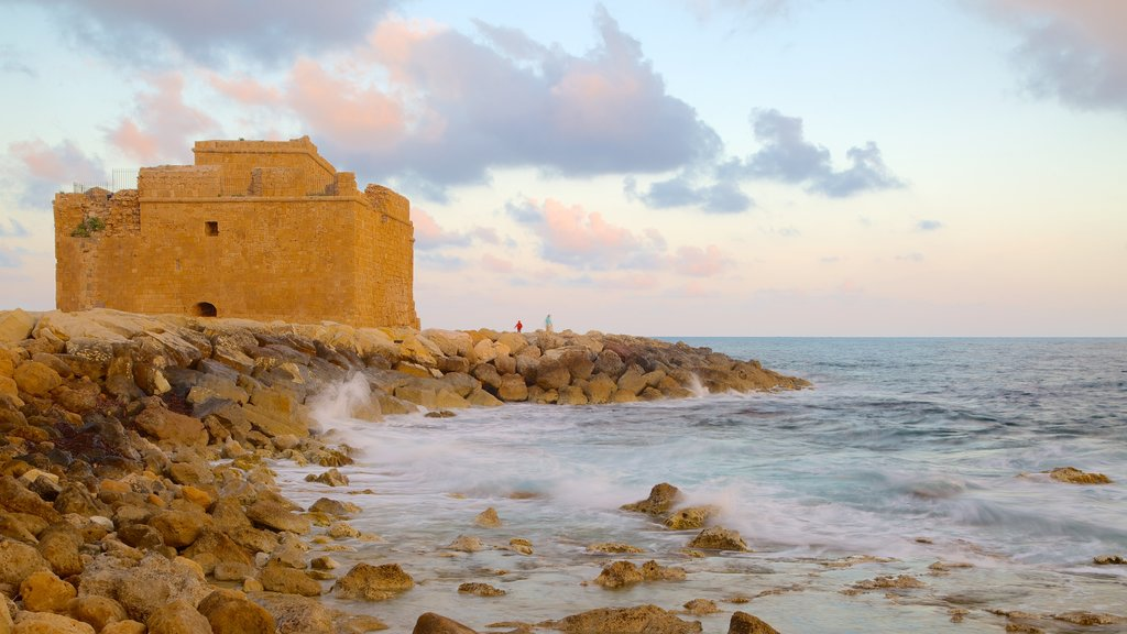 Paphos Castle showing a castle, rugged coastline and heritage architecture