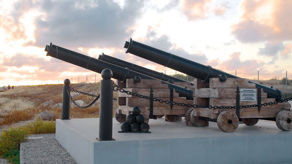 Paphos Castle which includes military items, a memorial and a sunset