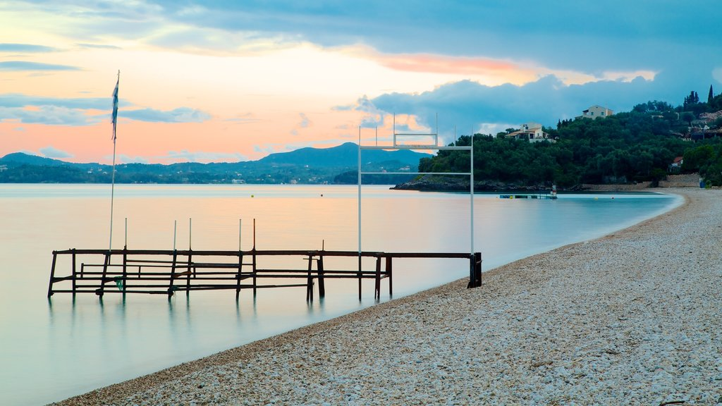 Barbati Beach which includes a sunset, a pebble beach and general coastal views