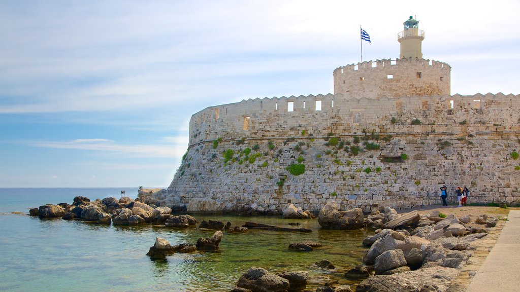 Rhodes featuring rocky coastline, chateau or palace and heritage architecture