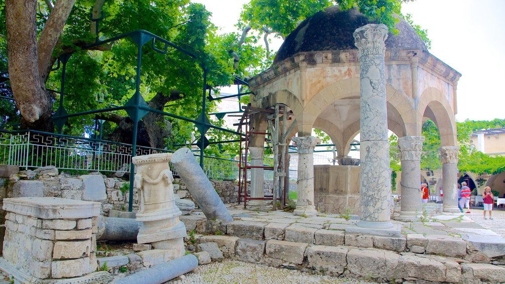 Tree of Hippocrates which includes heritage architecture and a ruin