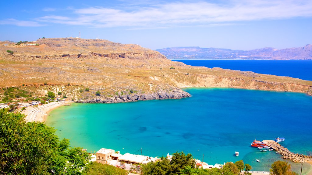 Lindos Beach which includes general coastal views and a bay or harbor