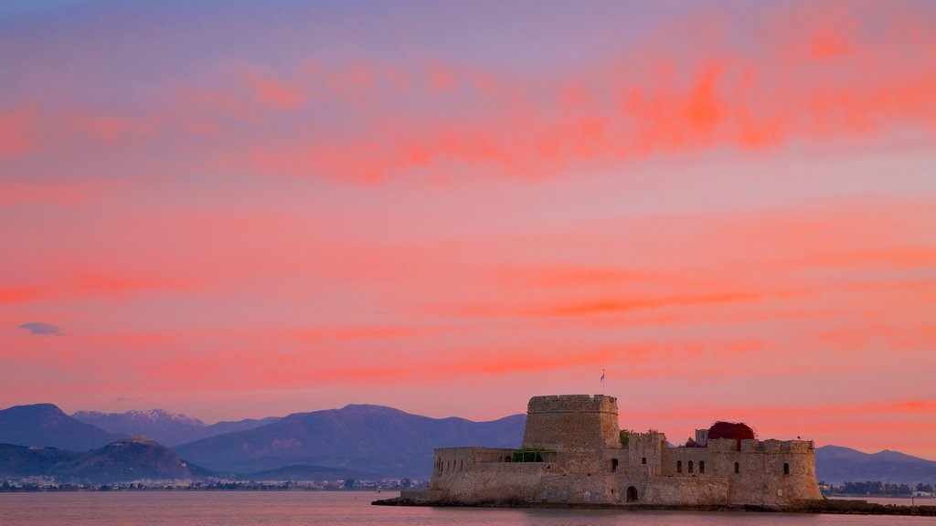 Greece showing a sunset and heritage architecture