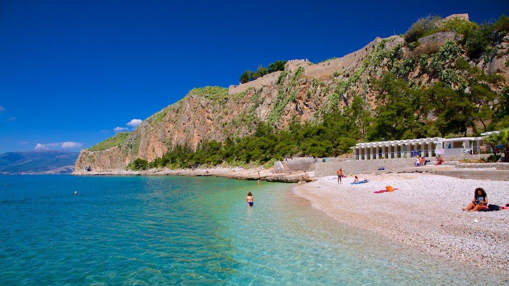 Arvanitia Beach featuring a pebble beach