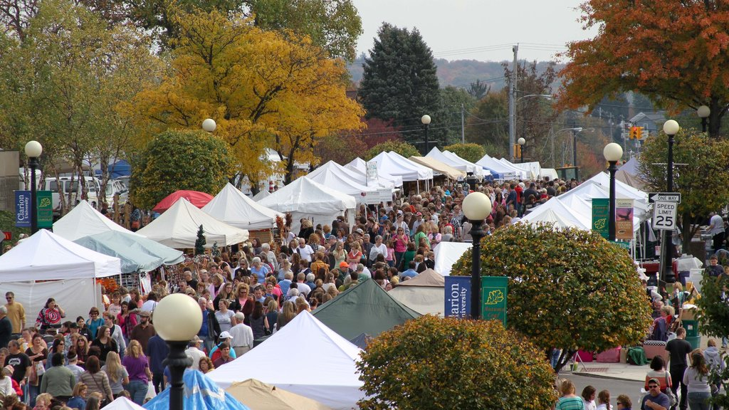 Clarion featuring markets as well as a large group of people